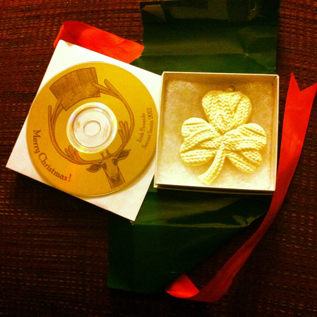 Thank you to my secret Santa George in New Jersey for his wonderful gift! A CD of some of his favorite Christmas music (some Irish, some traditional) as well as a gorgeous shamrock sweater ornament. It will hang on my tree every year and remind me how much I want to go to Ireland. I haven't been yet, but hope to go in a couple years! Thanks George!!! -- Heather