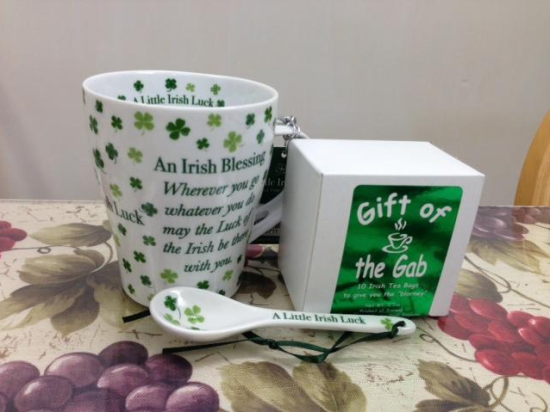 My Secret Santa from Sarah in New York included a beautiful Irish mug and spoon to give me a bit of Irish luck and some Irish tea to give me the gift of gab. Thanks so much, I love it! -- Bette