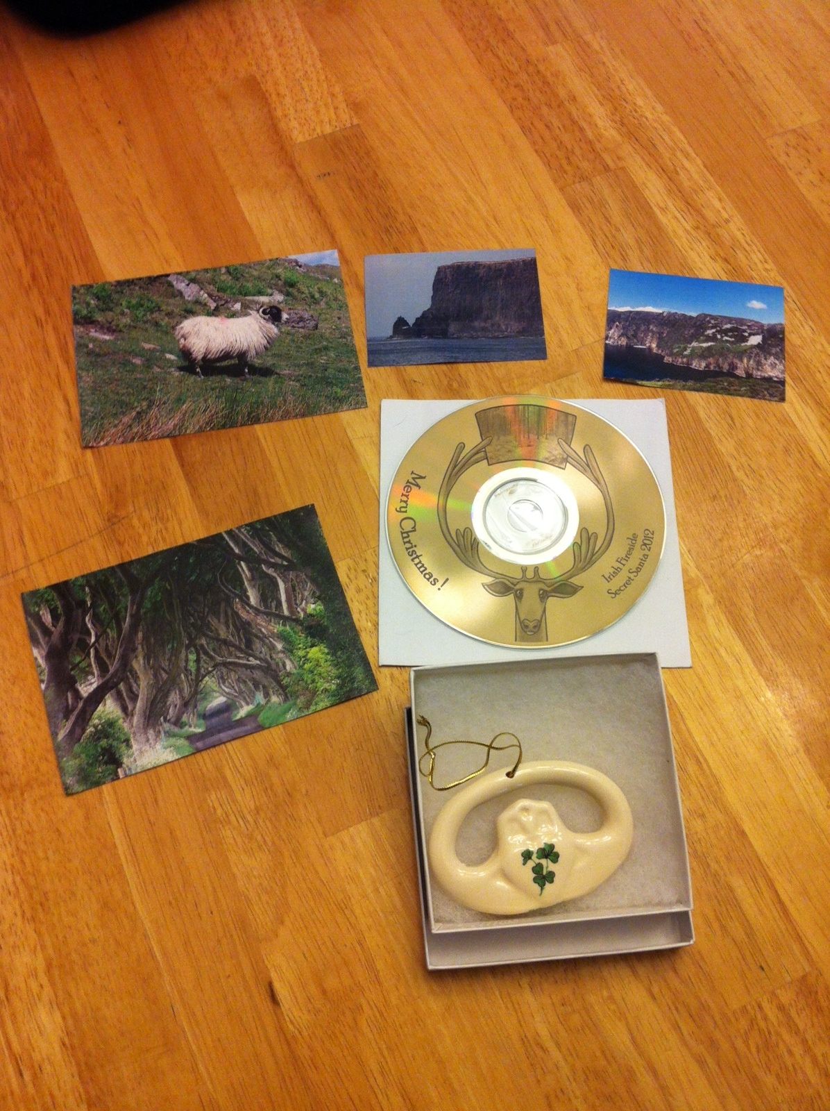 I received a lovely CD of traditional Celtic Christmas music, and ornament (a bisque Claddagh) and some fun pictures of Ireland that my Secret Santa Joan in New Jersey took on her last trip there! I am jealous and can't wait to go! -- Theresa