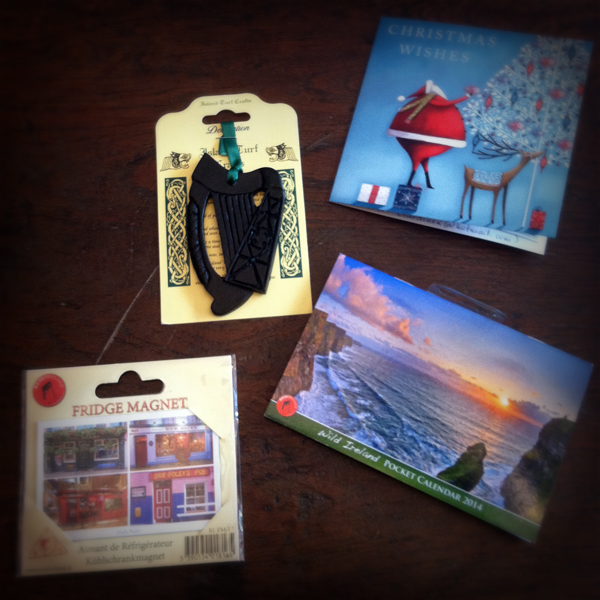 My Secret Santa present arrived from Claudine in Austria! She sent a harp ornament made out of turf, a pocket calendar, and a magnet of Irish pubs. AND one of the pubs pictured is Foley's Pub --my maiden name. So special. Thanks! -- Becky in Massachusetts