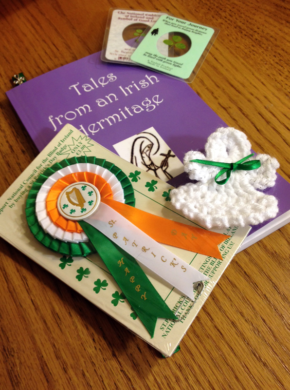 I opened a whole envelope of goodies... a book by an Irish nun, some lucky shamrocks, a St Patrick's Day ribbon, and a handmade angel. I love my little treasures from Judy in Texas. -- Pat in Michigan