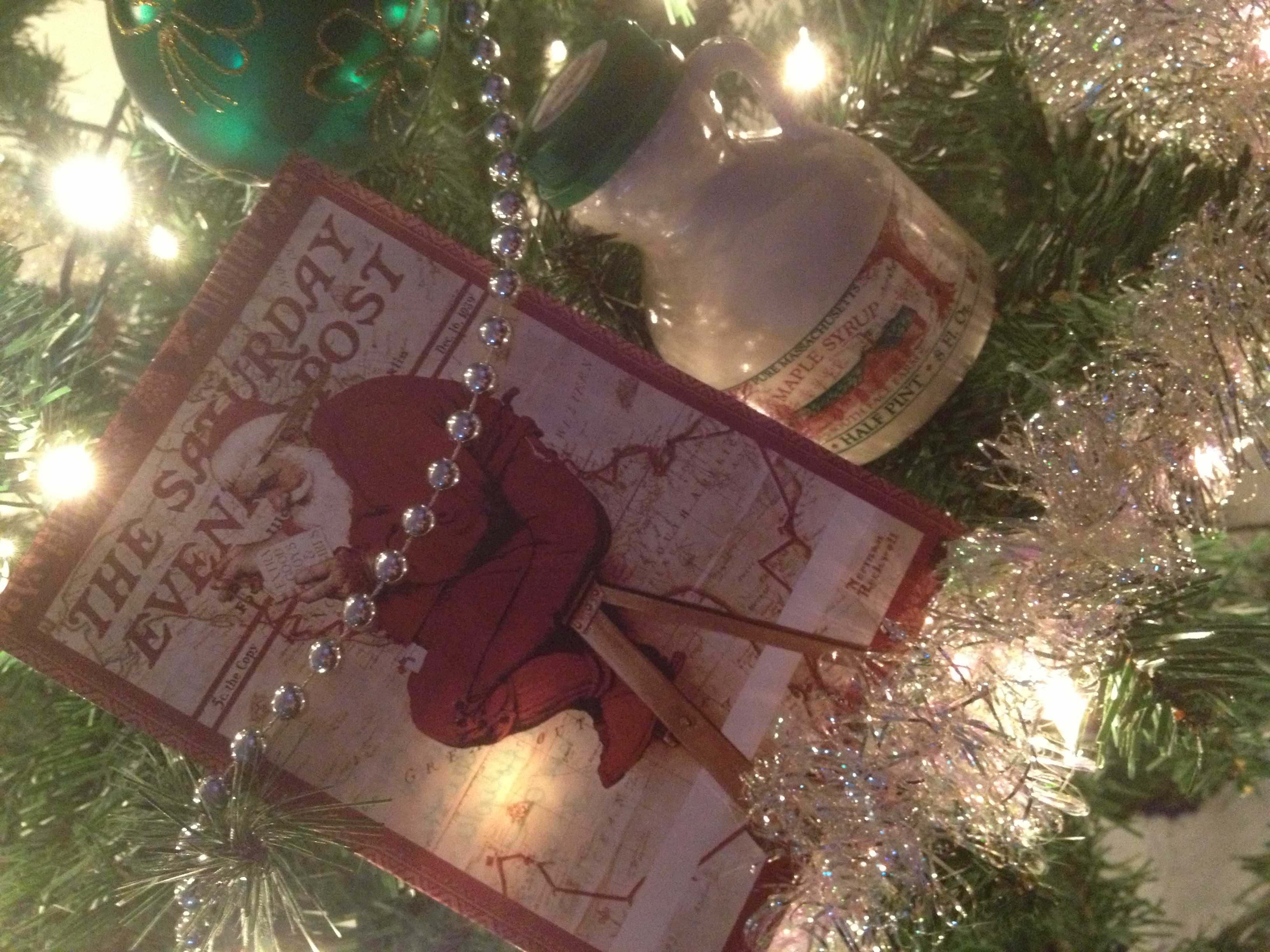 I got my gift from Alesia in Massachusetts today. She sent a cool Norman Rockwell Christmas card and a great little bottle of maple syrup. I'll have to make some pancakes on New Years Day! -- Travis in Idaho